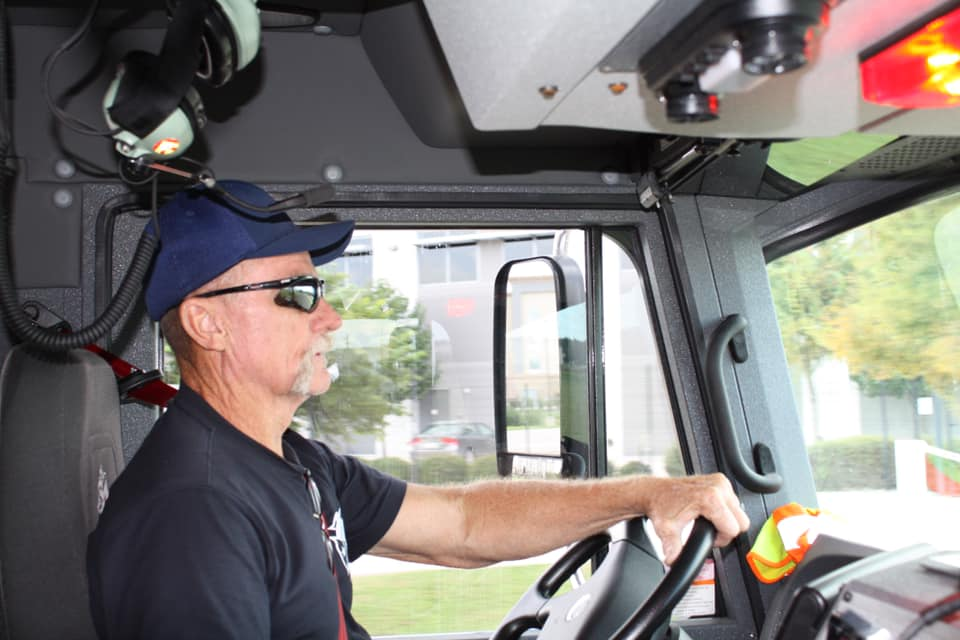 Howser driving the fire truck
